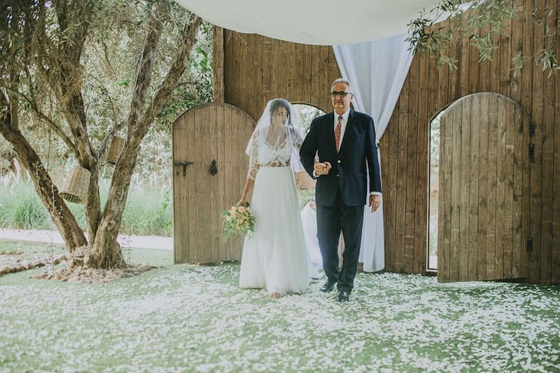 Father accompanying his daughter to her Moroccan wedding